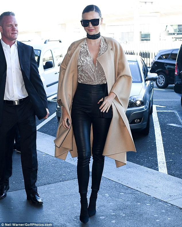 Model behaviour: Miranda showed no sign of fatigue as she used the airport's marbled floors as her own personal catwalk while teetering on suede stilettos