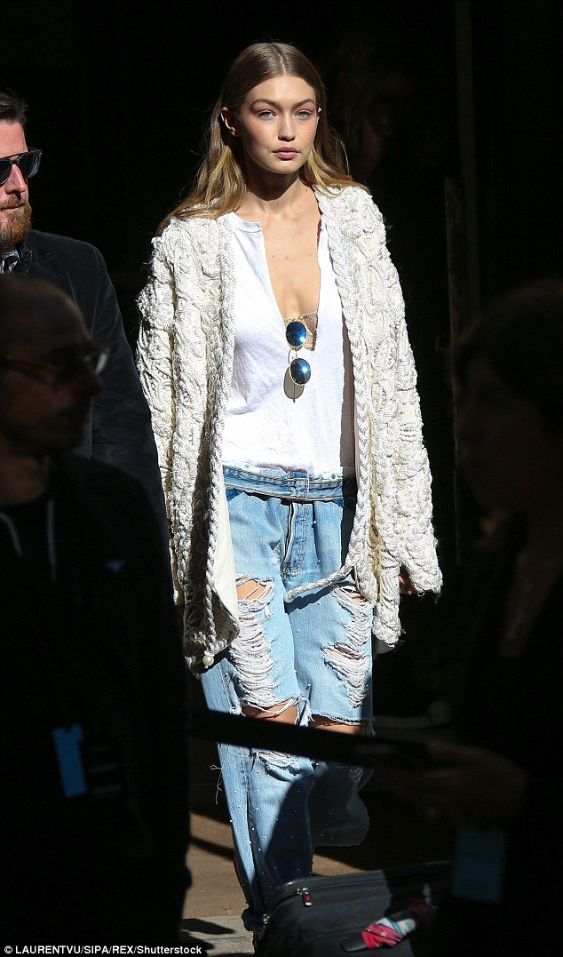 Going strong! Gigi Hadid does not appear to have tired of the couture festivities as she was seen beaming while departing the plush George V hotel on the last day of Paris Fashion Week on Wednesday