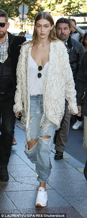 Leggy lady: Gigi showed off her long legs in her seriously distressed jeans
