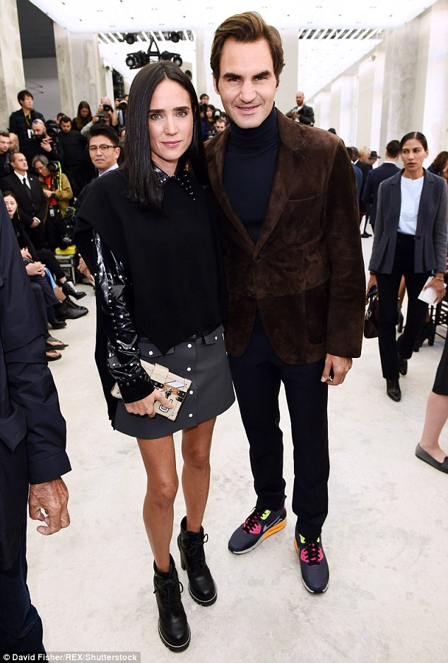 Those boots were made for stomping: Keeping to her punky theme, Jennifer (seen with Roger Federer) donned a pair of black block-heeled leather brogue boots
