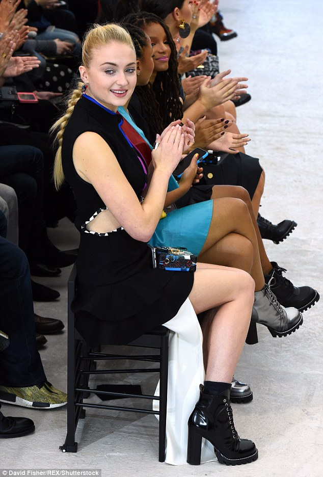 Round of applause: Sophie seemed to enjoy herself in the front row of the action