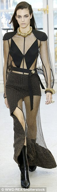 Strutting down the catwalk: The runway featured many outfits featuring cut out panels and mid-calf boots