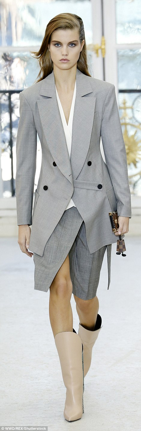 Never a grey day: Grey suits were also spotted on the runway, worn with box clutches