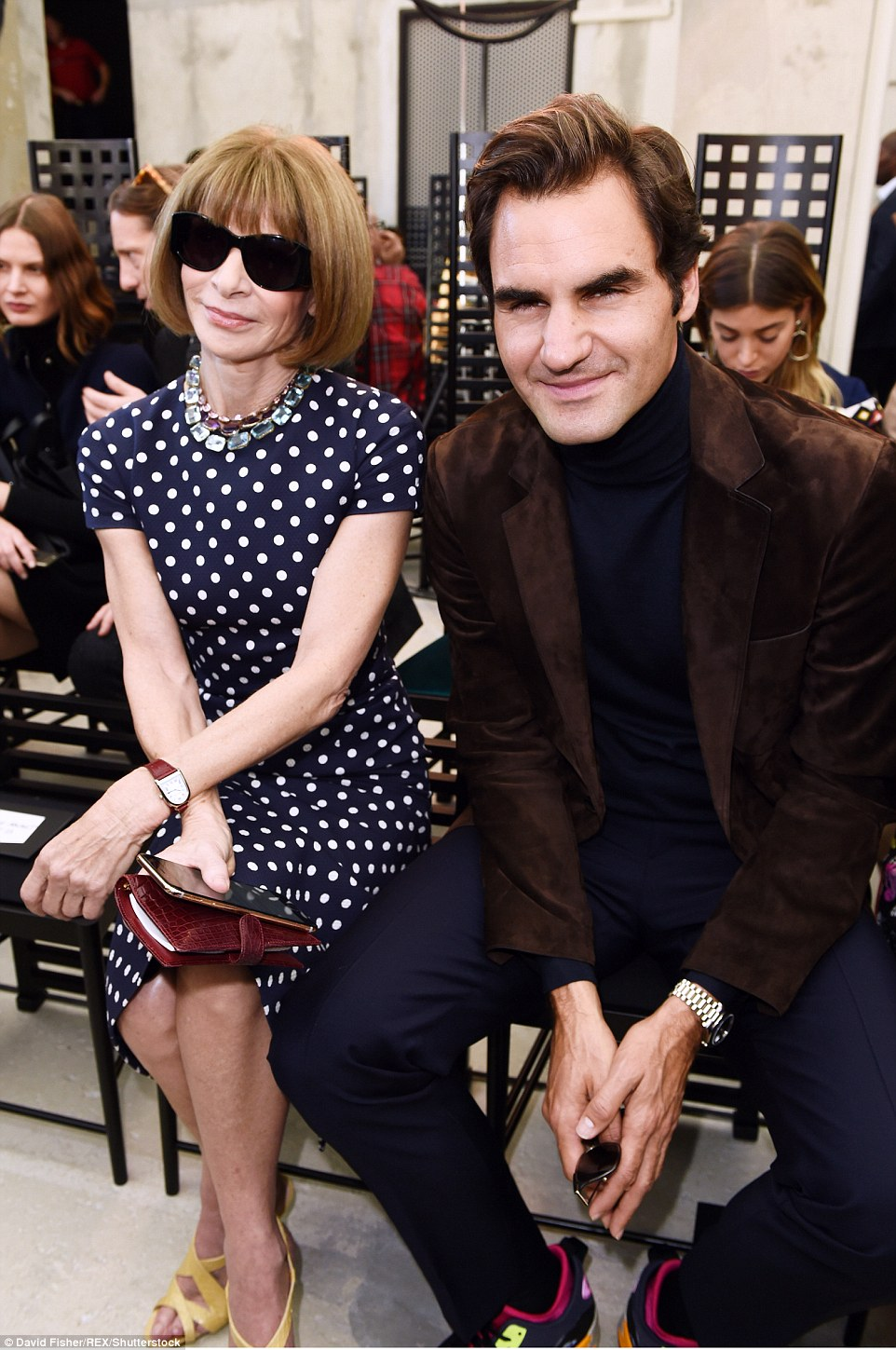 Shoe-business: He sat alongside American Vogue Editor-in-chief Anna Wintour who wore a polka dot dress and yellow Manolo Blahniks, while Federer stuck to Nike Air trainers