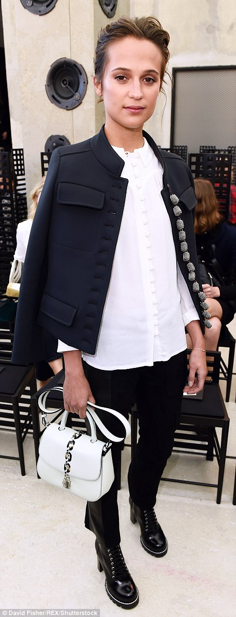 Suits her: Alicia Vikander chose a military-style jacket over a buttoned white blouse