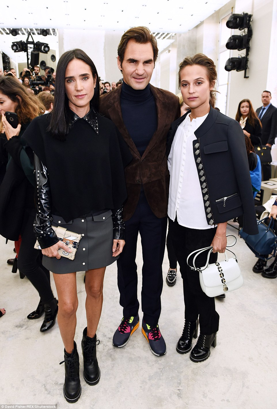 In good company: Roger also posed with Jennifer (left) and Alicia (right) who wore matching boots