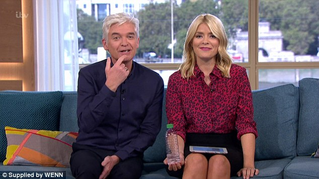 They can't believe it: Shocked Phillip Schofield and Holly Willoughby interrupt live broadcast to stare at naked lady sitting in a champagne glass who was outside their window