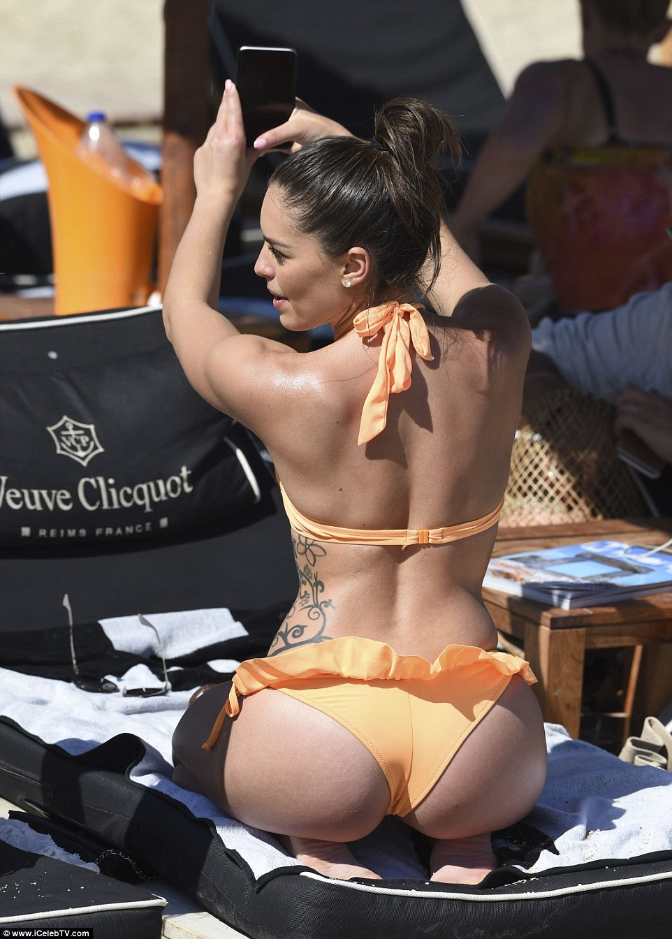 She's not shy! Olympia's hard-earned figure was the centre of attention on the beach