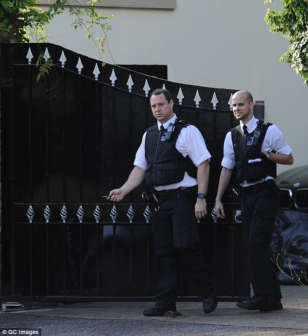 On the move: The officers left the mansion after their discussion with security guards
