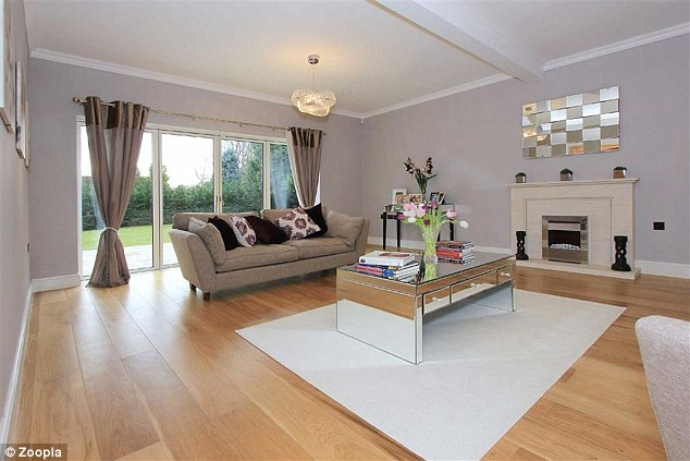 Some peace and quiet: If it's a spot of quiet time they're after there's another sitting room that leads out onto the patio and garden. The spacious room boasts comfy sofas, a marble fireplace and designer lighting