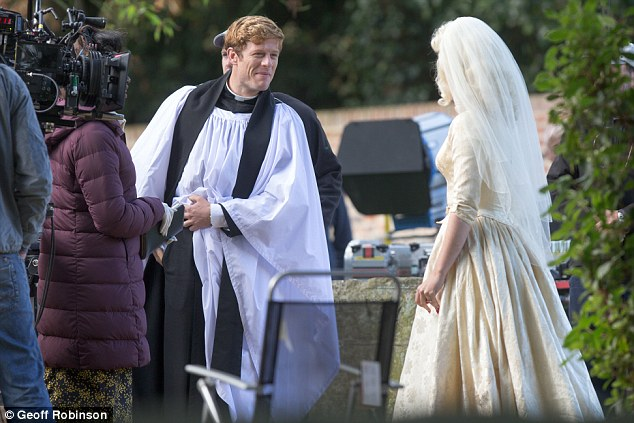 Wedding time:The actor, who plays Sidney Chambers in the detective series, looked dapper in his monochrome clerical attire as he took a break from shooting a wedding scene
