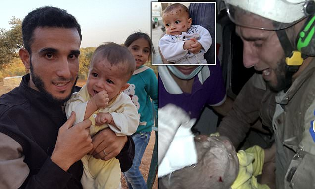 Syrian baby girl pulled ALIVE from the rubble is reunited with Abu Kifah
