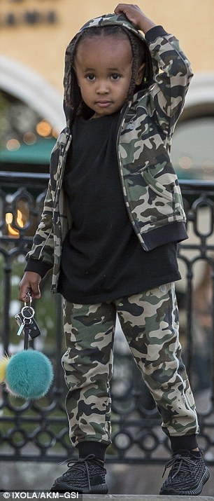 Undercover: Meanwhile King Cairo, who turns four later this week, looked adorable in a camouflage outfit and miniature Yeezys
