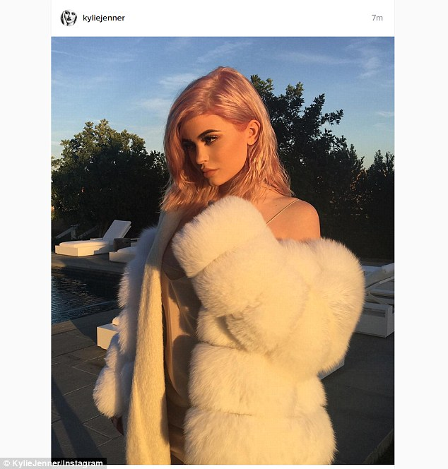 'Rose gold': Kylie Jenner debuted her exciting hair colour on Thursday but kept mum on Kim's robbery ordeal