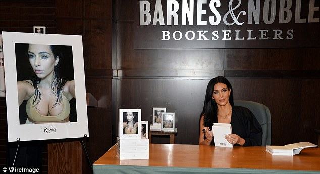 Jewelry heist: Kim Kardashian, shown signing her book of selfies, Selfish in May 2015 in Los Angeles, has cancelled all appearances since being robbed early on Monday in Paris