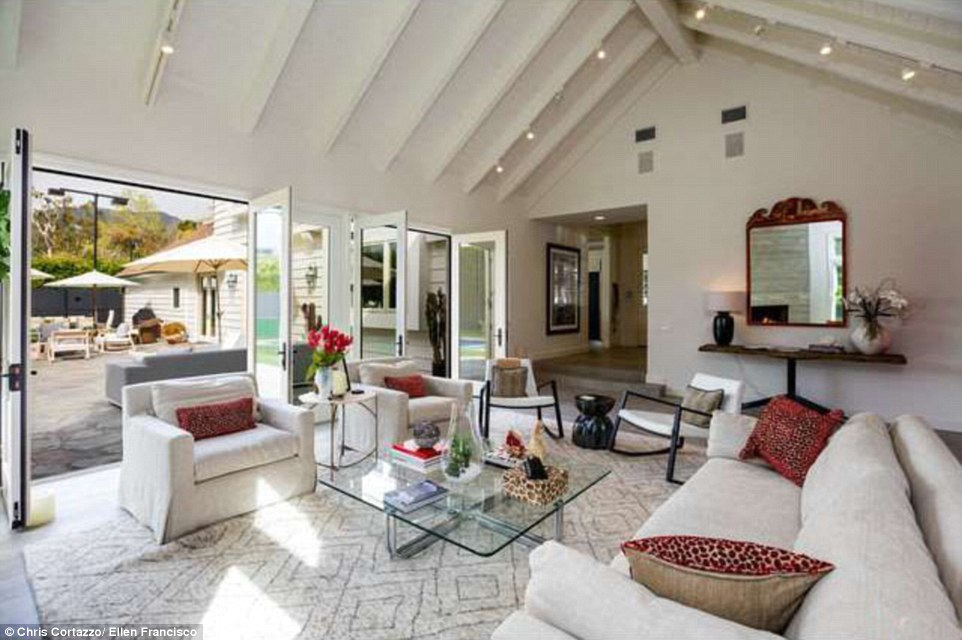A lot of room for the family: The4,415 square foot dwelling has high ceilings and a spacious living room