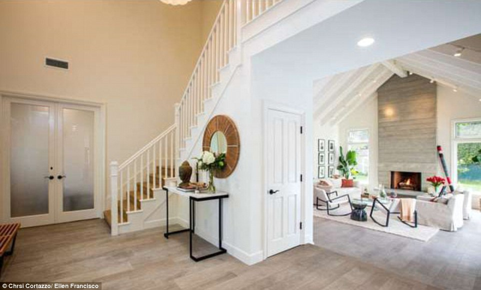 Stairway to heaven: Off the entrance way is a staircase that leads to the four bedrooms