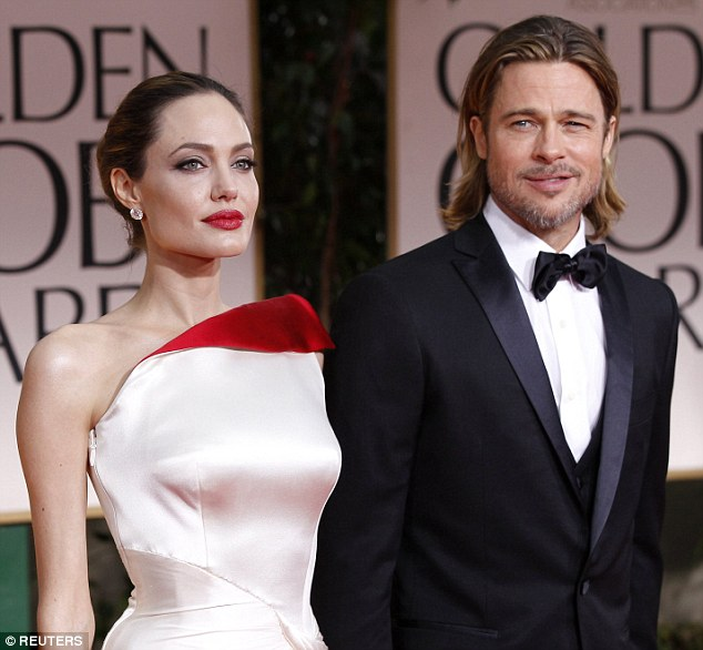 Tough times: Angelina Jolie filed for divorce from Brad Pitt on September 19 and things have been very tense ever since with the DCFS and therapists pitching in to make the situation smoother; her they are seen in 2012