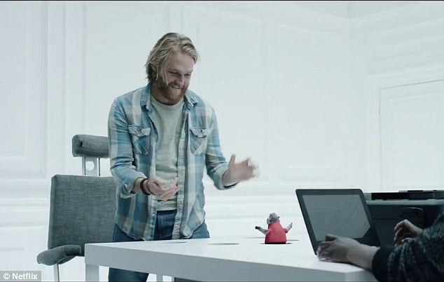 Game on: Wyatt Russell, on the other hand, enjoys a rather fun looking game of virtual whack-a-mole but considering he is will to undergo a small surgery to play, he probably is not going to be a winner in the long run