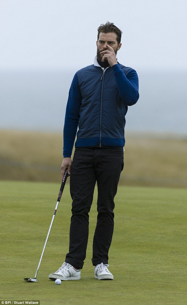 Hole in one: Sporting a hipster beard, he smouldered as he entertained onlookers with his impressive putting skills