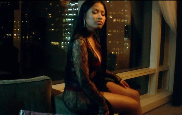 Sensual: Minaj rapped as she sat upon the arm of the couch