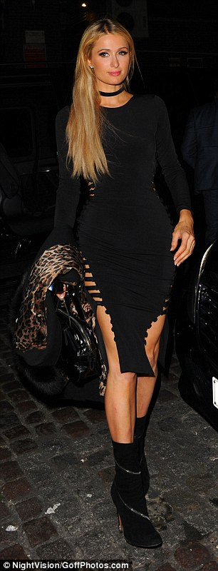 Racy lady: Paris Hilton, 35, sent pulses racing in a sexy dress as she arrived at the Chiltern Firehouse in London on Wednesday
