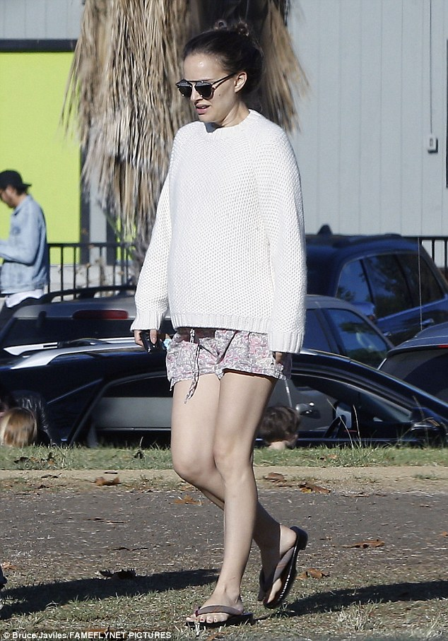 Out and about: The 35-year-old star's growing belly could be seen peaking through her baggy white knit sweater during the stroll in the affluent Los Angeles neighbourhood
