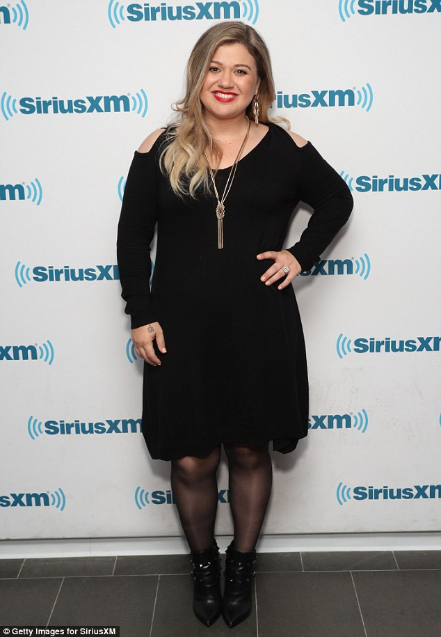 Back in black: Kelly Clarkson appeared on Jenny McCarthy's Sirius XM radio show Inner Circle on Wednesday as she opened up about making her husband get a vasectomy
