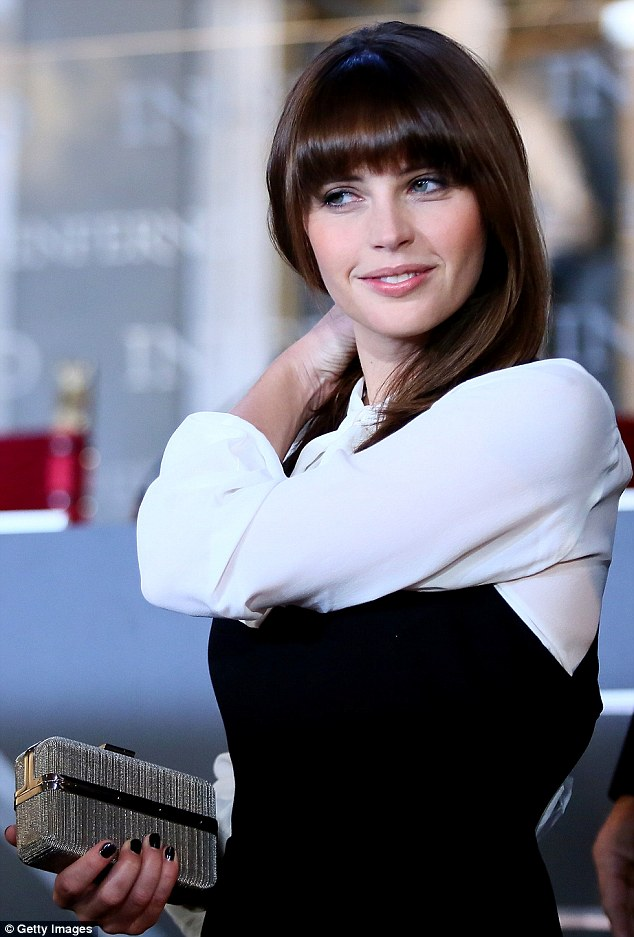 Fringe power:The brunette beauty sported an extra thick fringe and added a rosy blusher to her cheeks, completing the impeccably put-together look