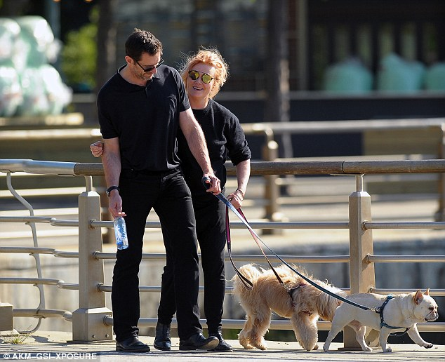 Together forever: On Thursday, Hugh Jackman, 47, and wife Deborra-Lee Furness, 60, looked affectionate as they took their dogs Dali and Allegra for a walk in New York