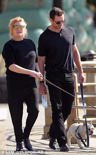 In step: The couple looked perfectly in sync in all black ensembles