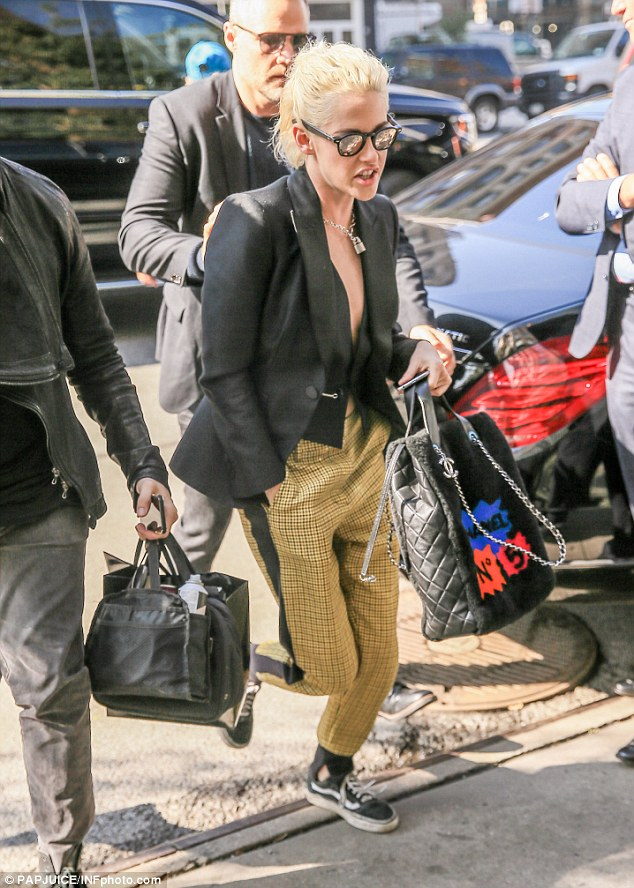 Making a comeback! Kristen Stewart brought back the punk era as she made a quick exit out of her car in New York on Thursday
