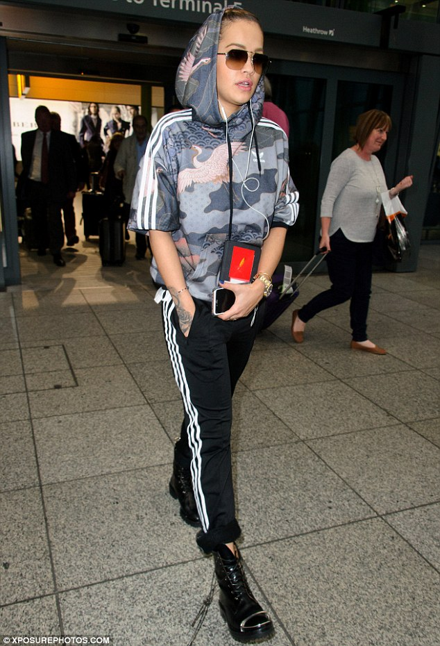 Casually cool: Rita managed to look incredibly stylish in a comfy tracksuit on Thursday as she landed at Heathrow Airport from her Italian getaway