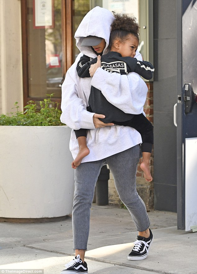 On the move: Kim left her NYC apartment on Thursday carrying her three-year-old daughter North after being holed up at the premises since Monday