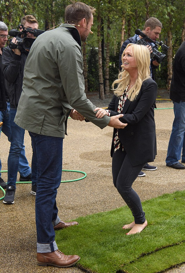 Helping hand: Co-host Jamie Theakston and friend (above) met her at the other end to congratulate her