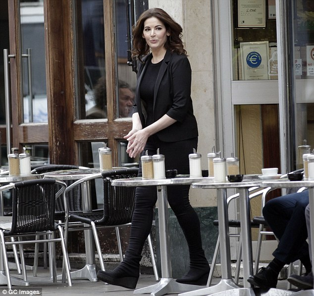 Warming up: Nigella rubbed her hands together as she stepped out in the chilly autumnal air