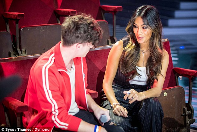Crunch time: Ryan Lawrie, 20, was gaining advice from mentor Nicole Scherzinger during rehearsals at London's Fountain Studios for The X Factor's first live performance this weekend