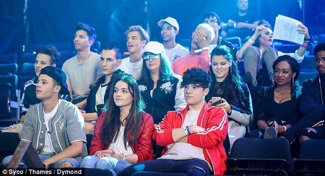 Attached at the hip: Ryan's girlfriend Emily Middlemas, 17, kept her beau close as she awaited her turn to run her song of choice through with mentor Simon Cowell