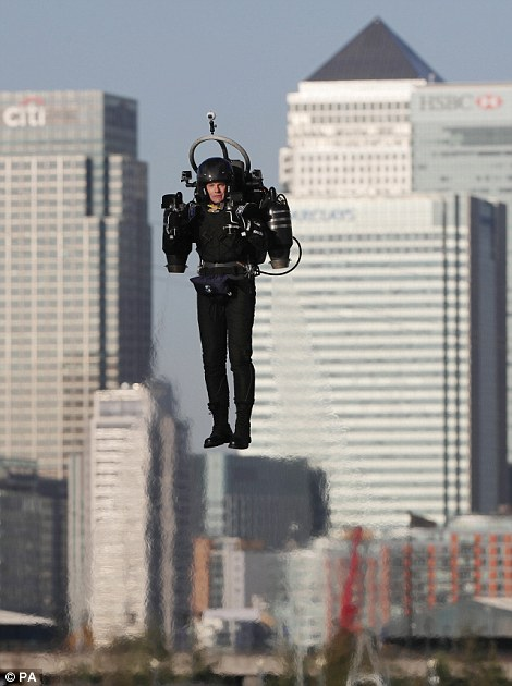 Mr Mayman looked like a real-life James Bond as he soared above the River Thames in east London (pictured)