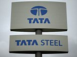 A Tata Steel sign is seen outside their plant in Scunthorpe northern England, October 15, 2014.  India's Tata Steel Ltd is in talks to sell loss-making European operations including mills in northern England and Scotland to Geneva-based Klesch Group, as it battles weak prices and tentative economic recovery. REUTERS/Phil Noble (BUSINESS INDUSTRIAL)
