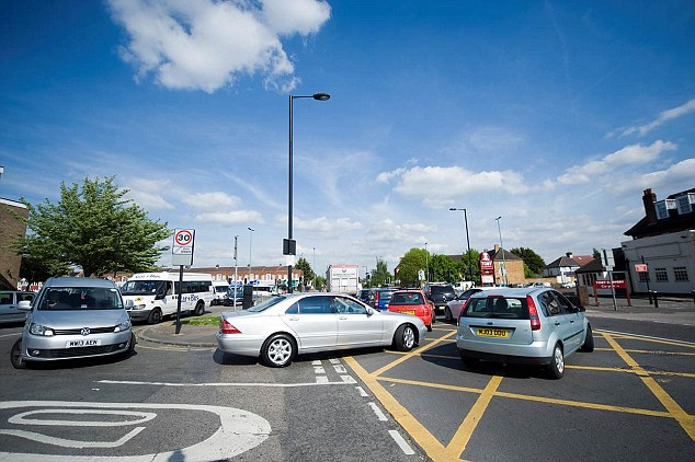 Money boxes: London councils are pocketing millions of pounds from yellow box junction fines, such as this one in Enfield which featured in a BBC investigation on Monday