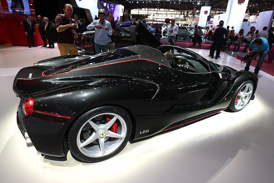 Star attraction: The Ferrari stand at any motor show is a busy place, and Thursday was no exception