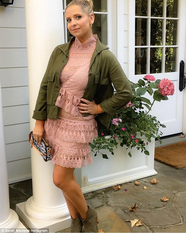 Absolutely beautiful: The Buffy The Vampire Slayer star looked gorgeous in the light pink frock, which had lacy ruffles across the waist and skirt as well as a turtleneck-style neckline