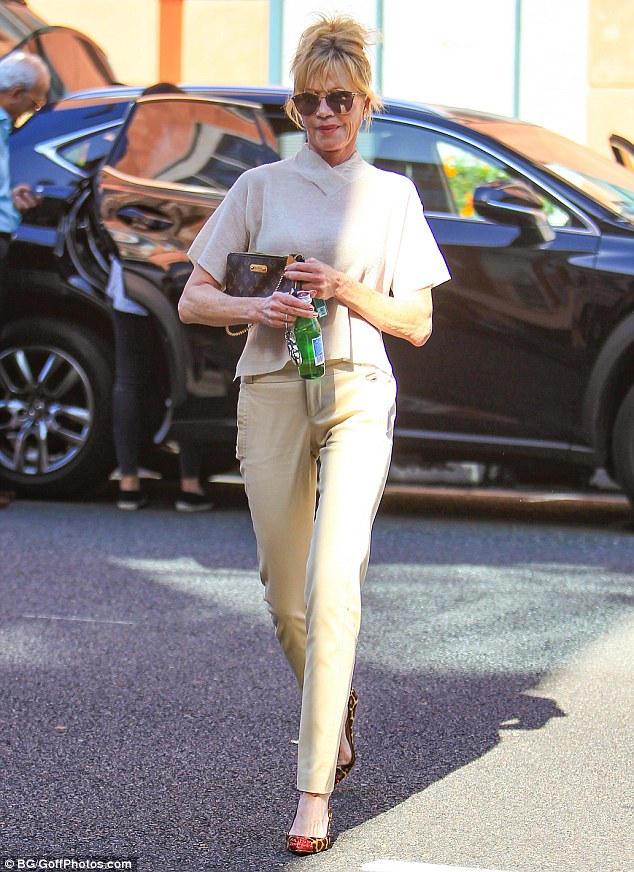 Working it: The Working Girl actress opted for a casual yet chic ensemble as she sported an all beige outfit while enjoying the Californian sun