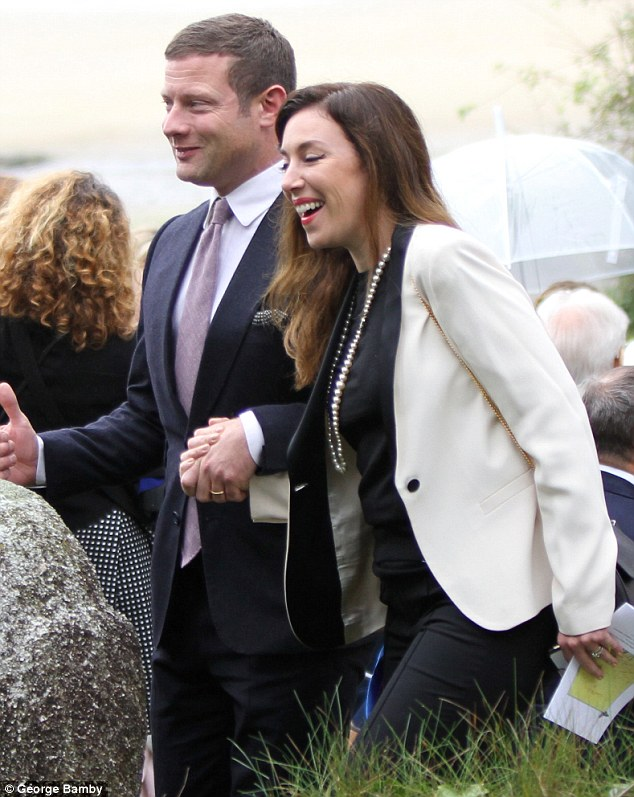 Closer than ever: The loved-up pair clasped onto each other's hands tightly as they exited the ceremony in their impeccably stylish fashion