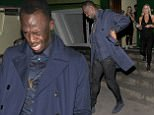 6 October 2016. Usain Bolt leaves Embargo Club in Chelsea, appearing rather worse for wear. A pretty young blonde girl left the club with Bolt, but when they spotted snappers, she turned and ran off, leaving Bolt to head home alone! Credit: Will/GoffPhotos.com   Ref: KGC-305