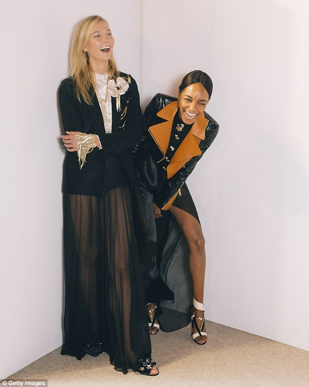 Ready to wow: Karlie shared a giggle with her good pal Jourdan Dunn as they posed backstage ahead of the show