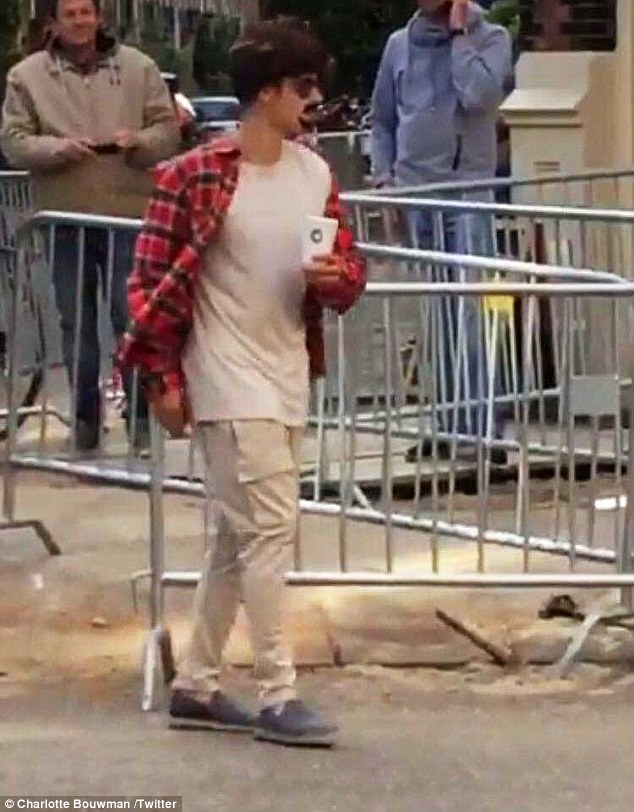'Does this look real?' Justin Bieber, 22, wore a bizarre disguise as he stepped out in Amsterdam on Friday to grab a coffee