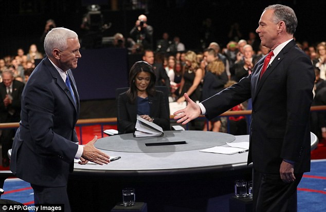 Mr Pence (left) and Mr Kaine (right) shook hands at the end of last night's debate but the pair hurled insults about each other's running mates when it came to their policies on Russia