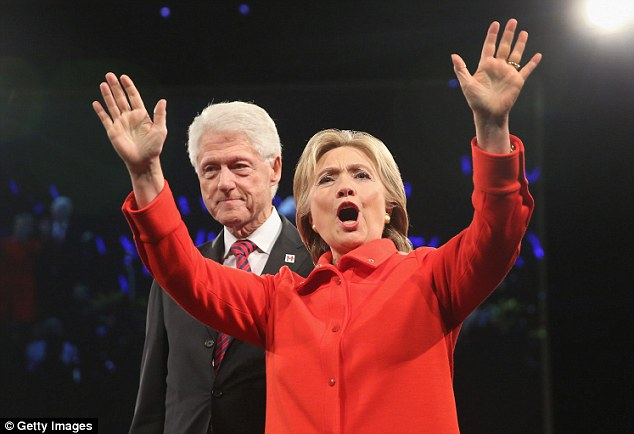 Many Russian analysts believe Putin would prefer to deal with Donald Trump rather than Hillary Clinton (pictured, with husband Bill)